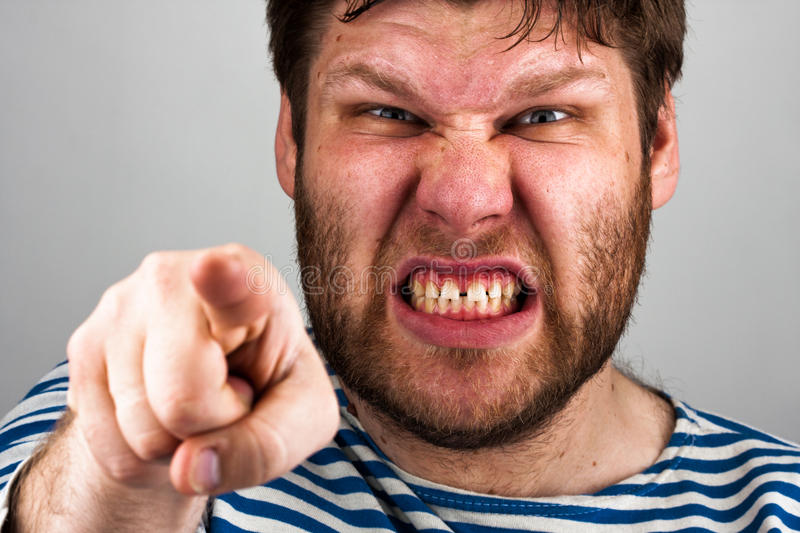 Angry bearded man pointing to you royalty free stock image