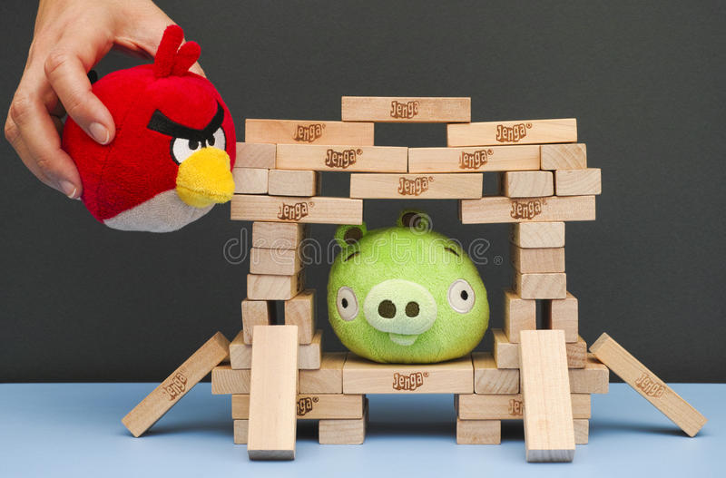 Angry Bird game with soft toys and Jenga bricks. Tambov, Russian Federation - March 03, 2016 Bad Piggy sitting inside of house, made from Jenga bricks. Red Angry royalty free stock photos