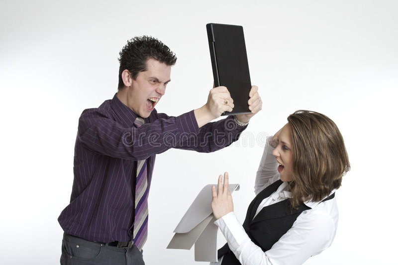 An angry boss. A boss hitting his employee with the laptop royalty free stock photos