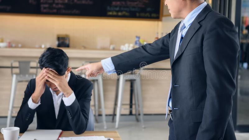 Angry boss complain young businessman stock photo
