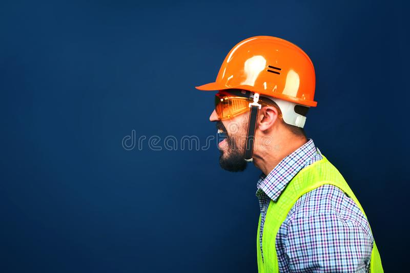 Angry boss construction superintendent screaming at workers. Copy space royalty free stock image