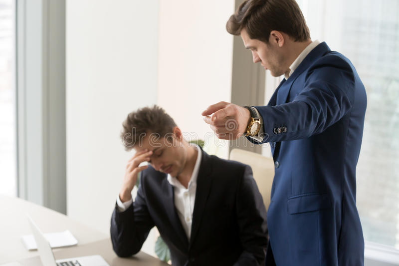 Angry boss dismissing frustrated upset subordinate, getting fire stock image