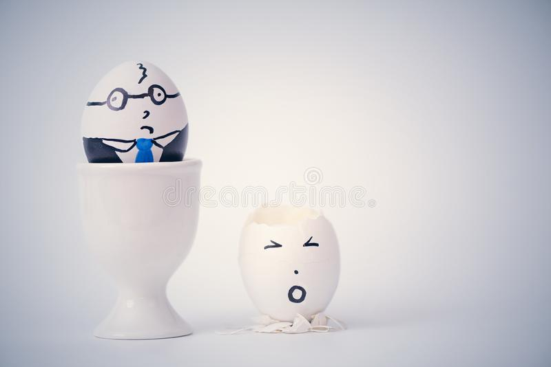 Angry boss and employee in the form of white eggs.  Creative. Concept royalty free stock photography