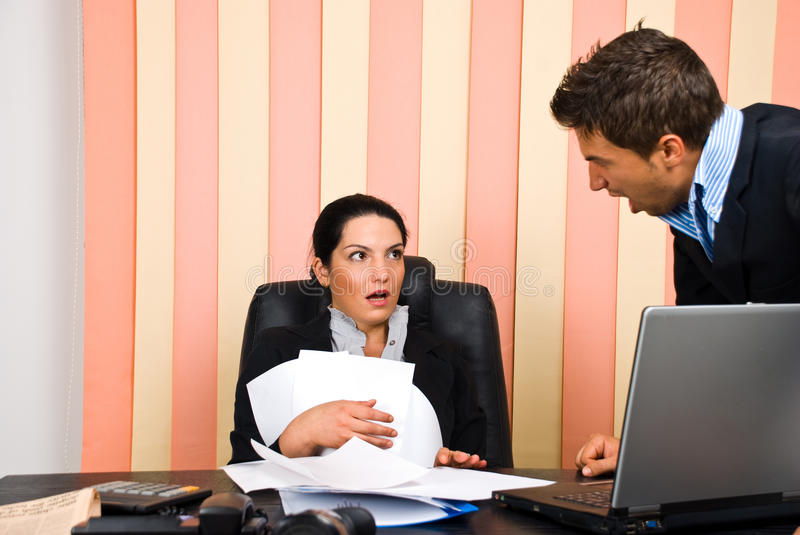 Angry boss with employer. Angry boss screaming to his employer woman and she is surprised and shocked,check also stock photography