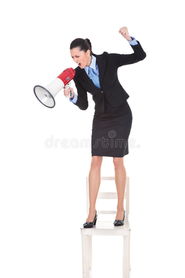 Angry boss with megaphone on chair. Angry boss with megaphone yelling and standing on chair, shoving protest, isolated on white background stock images
