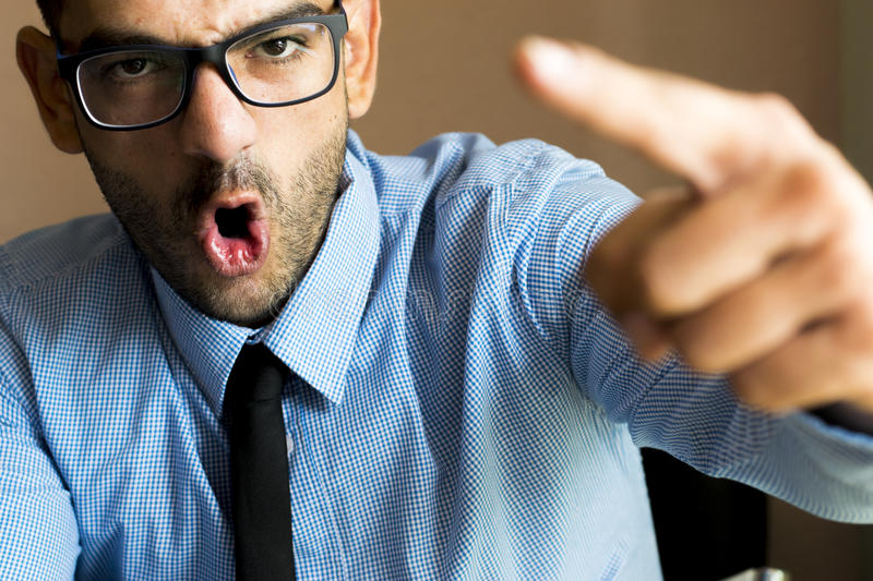 Angry boss. At office expressions. raw format stock images