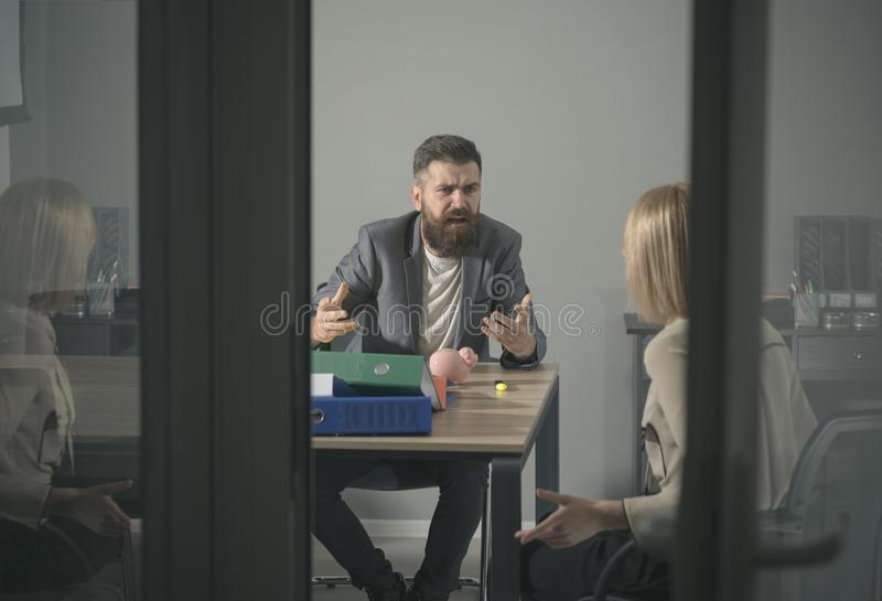 Angry boss shout at accountant in office. Bearded man and woman discuss company budget. Businessman blame financier in stock photos