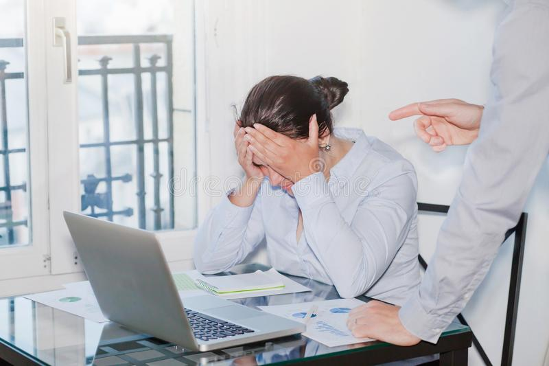 Angry boss and stressed employee in the office stock photography
