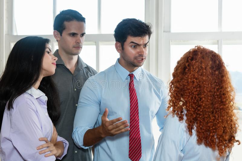 Angry boss talking to lazy employee royalty free stock image