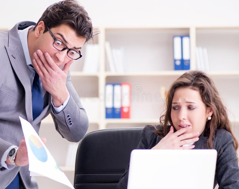 Angry boss unhappy with female employee performance. The angry boss unhappy with female employee performance royalty free stock photo