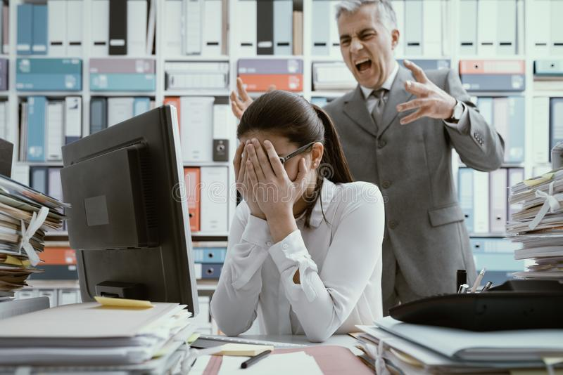 Angry boss yelling at his young employee stock photos