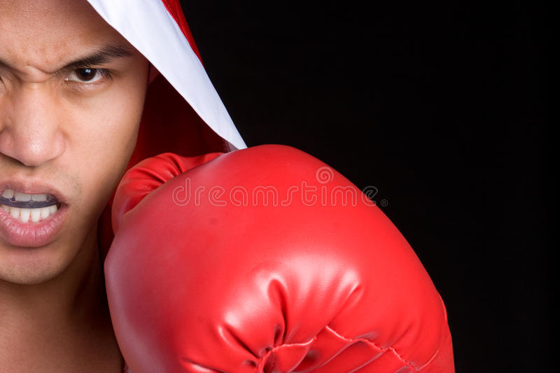 Angry Boxing Man. Angry athletic asian boxing man stock images