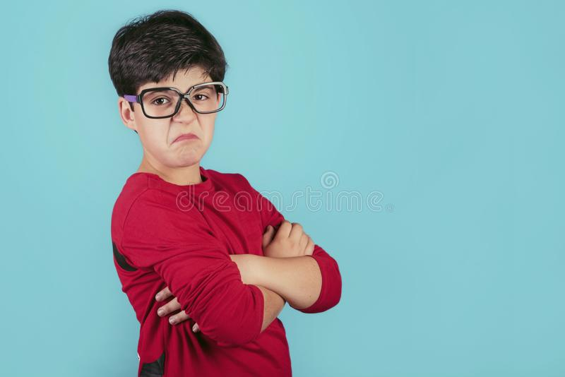 Angry boy with glasses stock photos