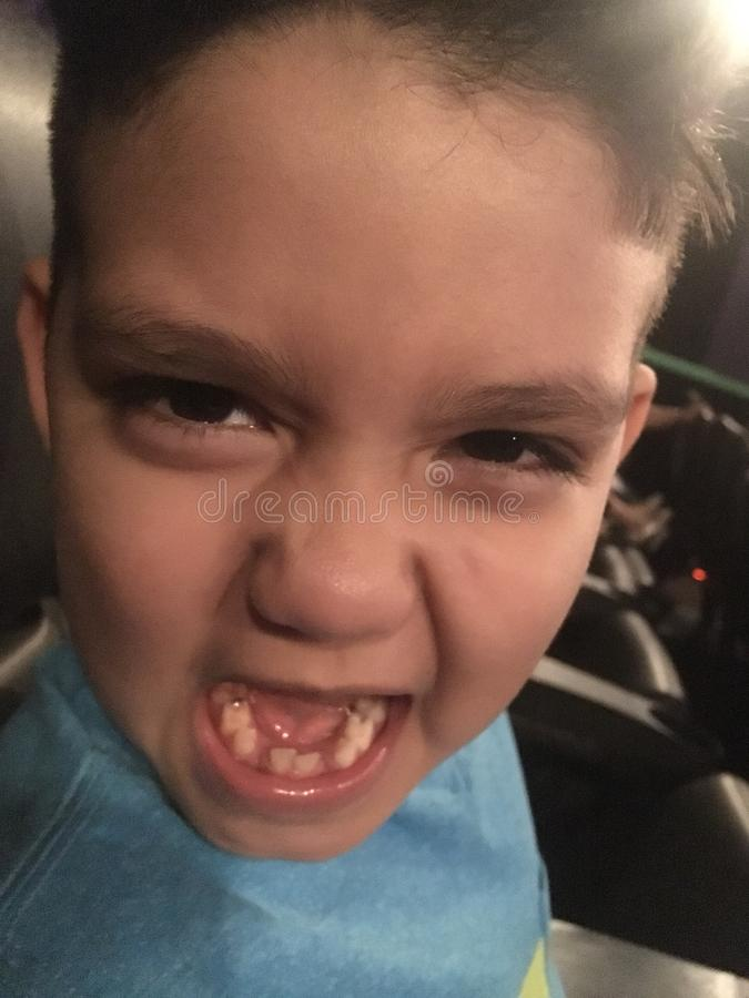 Angry boy missing teeth stock image