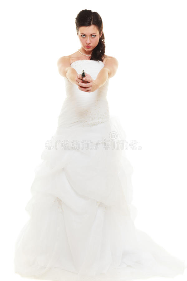 Angry bride with gun isolated on white. Wedding Day. Angry betrayed bride concept. Woman in white dress with gun isolated on white. Studio shot royalty free stock photo