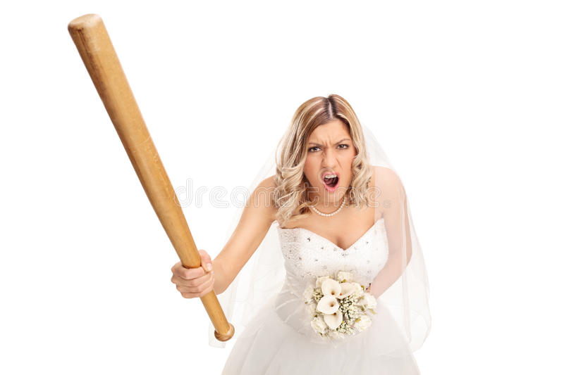 Angry bride holding a baseball bat and yelling. Angry young bride holding a baseball bat and yelling on white background stock photography