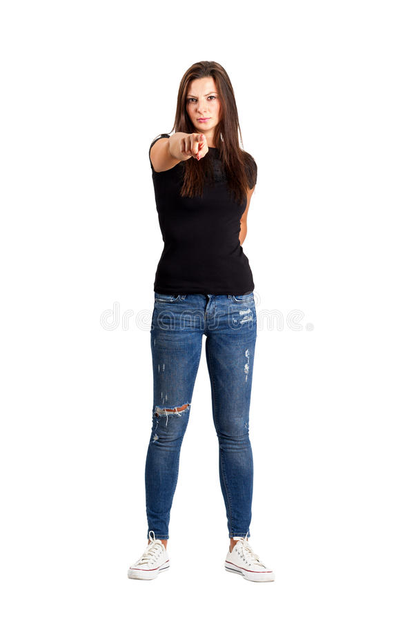 Angry brunette beauty pointing finger at camera. Full body length isolated over white royalty free stock images