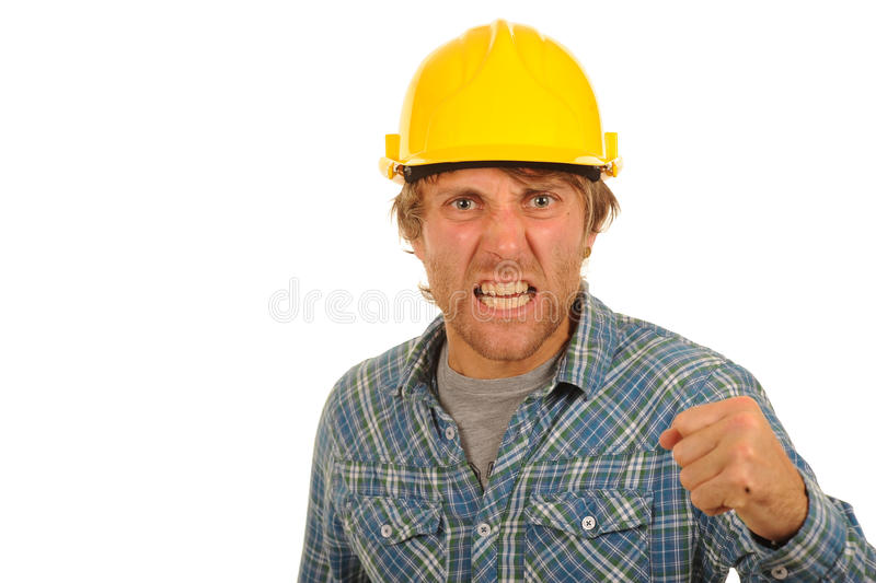 Angry builder. Portrait of angry builder in check shirt with yellow hard hat shaking fist; isolated on white background stock image