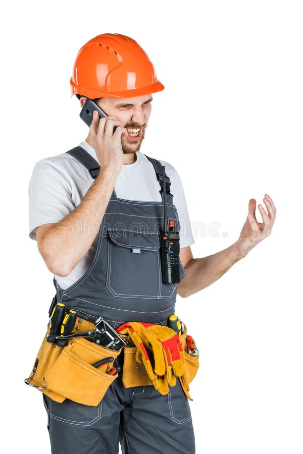 An angry builder says and screams on the phone. Repair and construction. Isolated on white background stock images