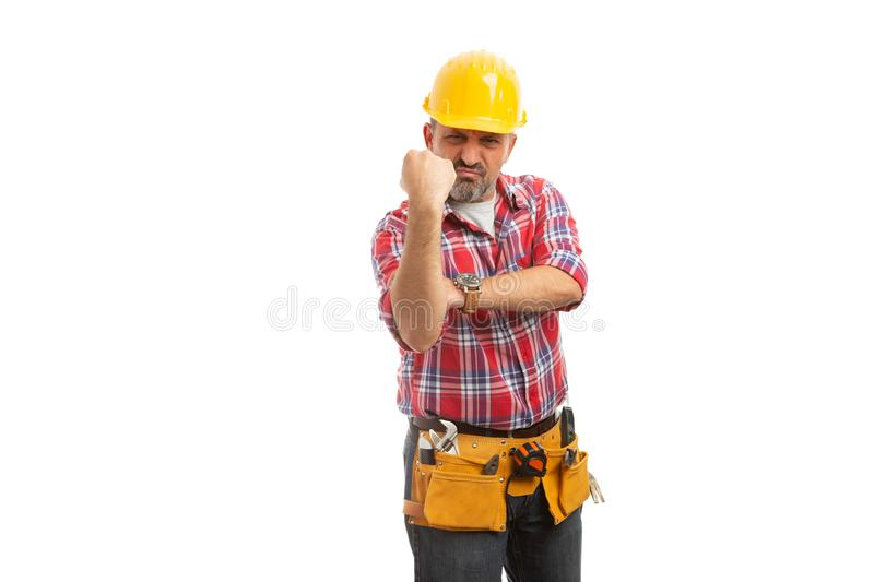 Builder showing fist as obscene gesture royalty free stock photography