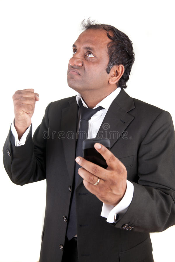 Angry business man with mobile phone royalty free stock photo