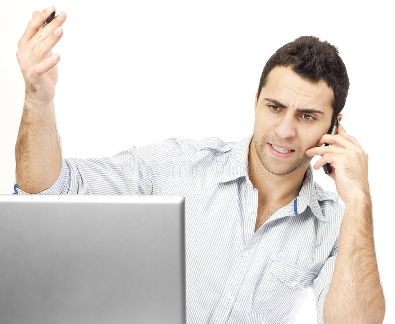 Angry business man on the phone stock image