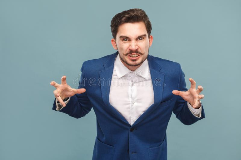 Angry business man roar at camera stock photo