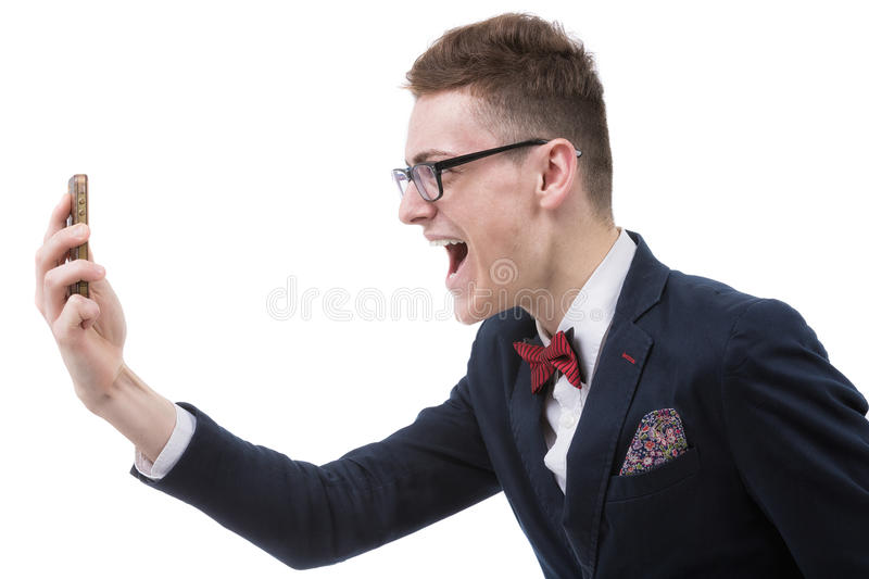Angry business man screaming on cell mobile phone, portrait of y stock images