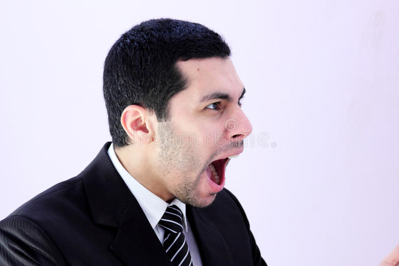 Angry business man screaming stock photo