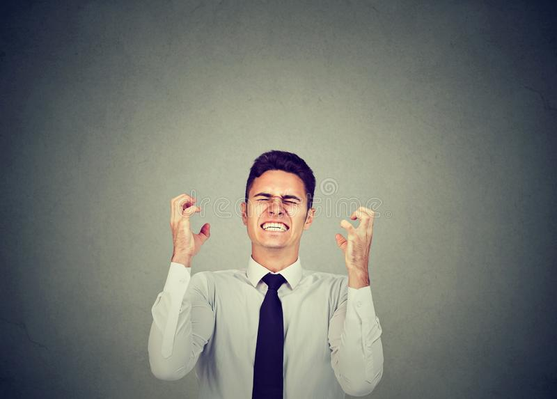Angry business man shouting in frustration stock images