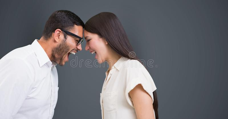 Angry business people with head to head screaming against gray background stock illustration