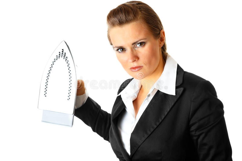 Angry business woman menacingly holding iron stock images