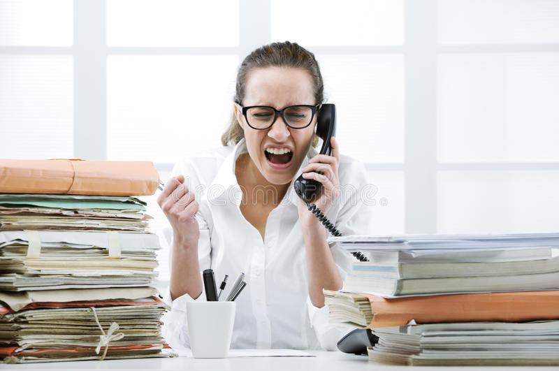 Angry Business woman Shouting At Phone