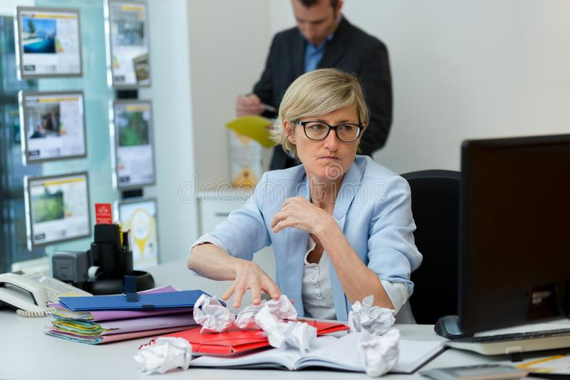 Angry business woman solving problem royalty free stock image