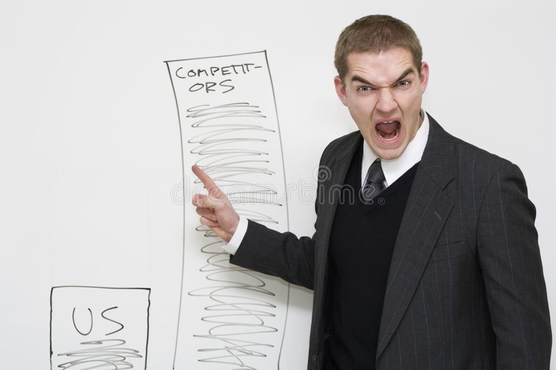 Angry Businessman. A supervisor expresses emotion over sales chart royalty free stock photo