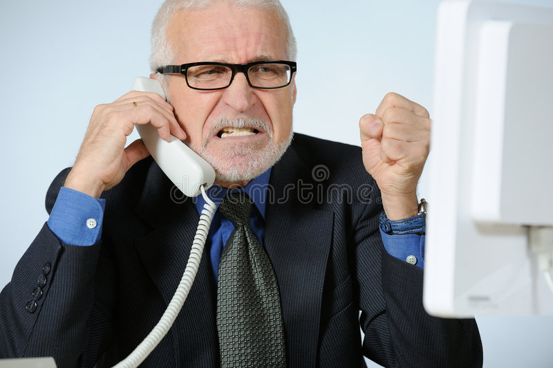 Angry businessman. Horizontal image of angry senior businessman stock photography