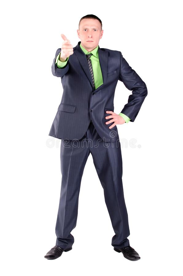 Angry businessman or boss. Angry businessman or boss is scolding someone and is pointing ahead by his index finger isolated on the white background stock image