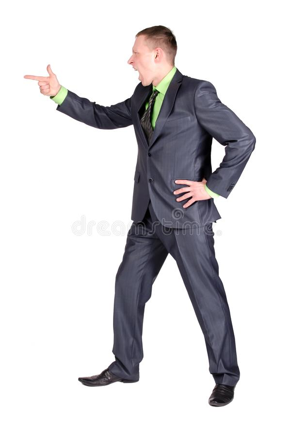 Angry businessman or boss. Angry businessman or boss is scolding someone and is pointing ahead by his index finger isolated on the white background royalty free stock image