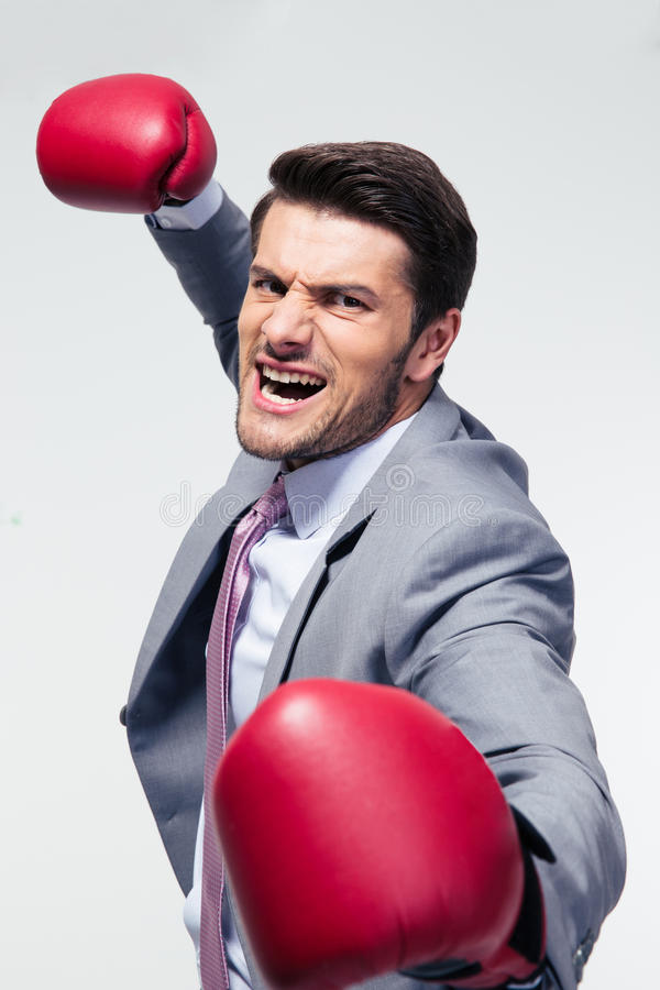 Angry businessman with boxing gloves stock images