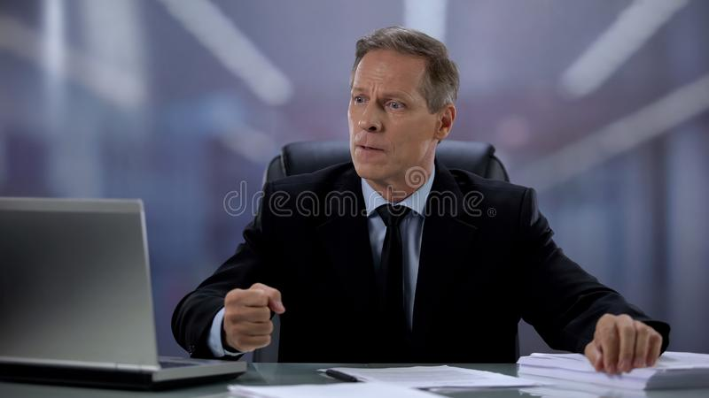 Angry businessman displeased with bad news, receiving e-mail on laptop, fail. Stock photo royalty free stock photos