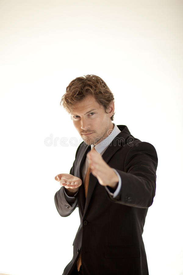 Angry businessman doing karate stock photography