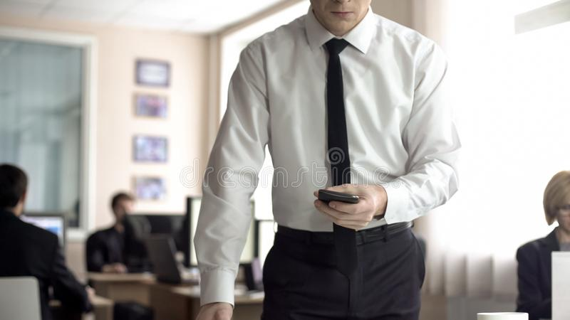 Angry businessman holding cellphone, worrying about problems at work, overwork. Stock photo royalty free stock image