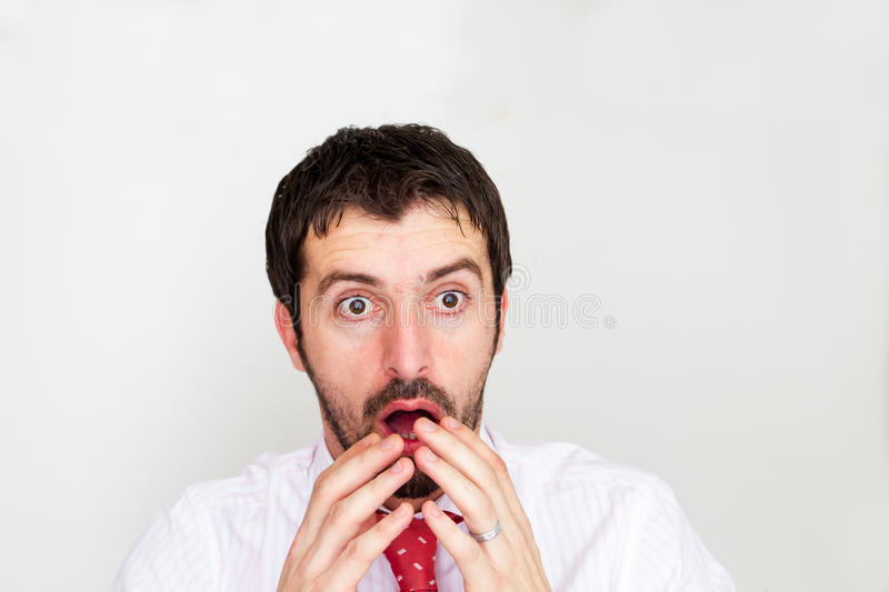 Surprised businessman with stock photography