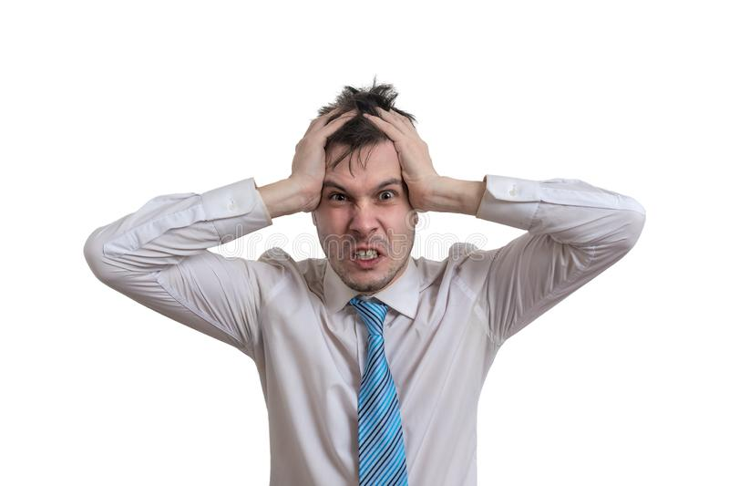 Angry businessman is holding his head. Isolated on white background. Angry businessman is holding his head. Isolated on white background stock image