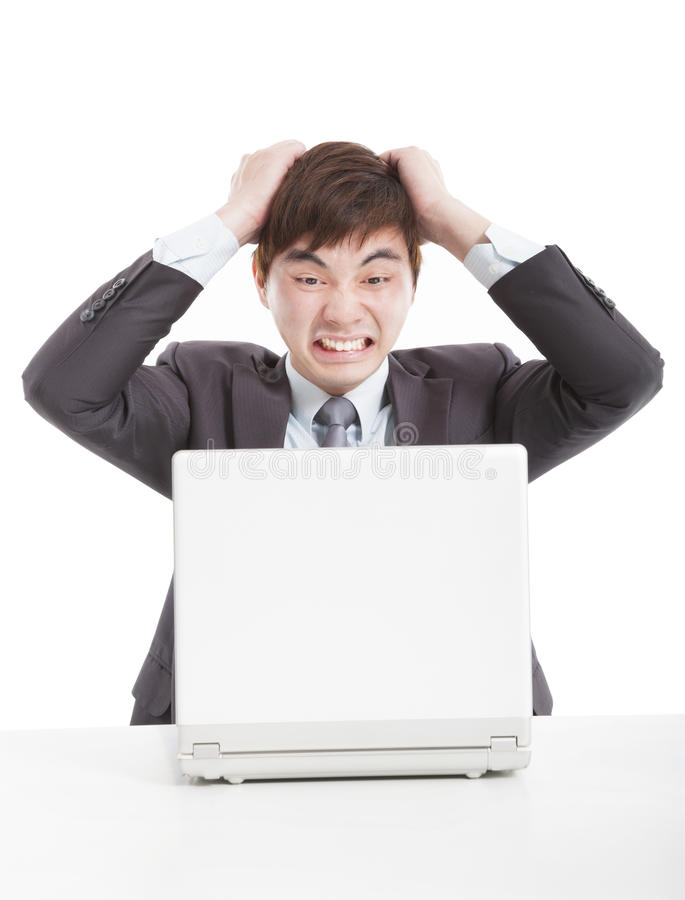 Angry businessman with a laptop stock photos