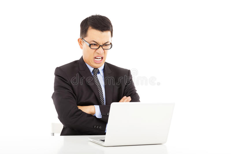 Angry businessman look at laptop and cross arms stock photos