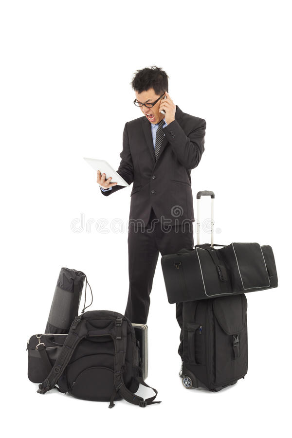 Angry Businessman On The Phone And Holding Tablet Stock Photo