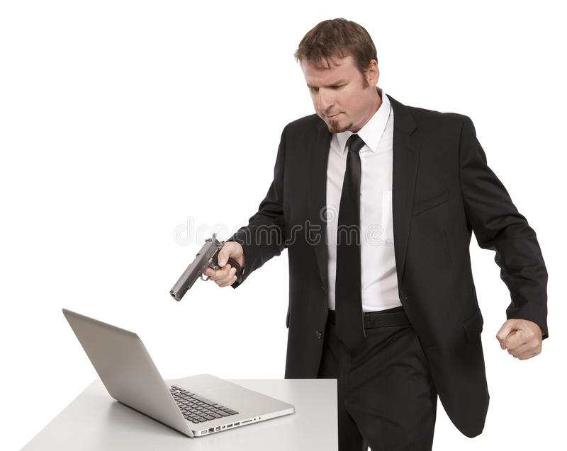 Angry Businessman points gun at computer stock photos