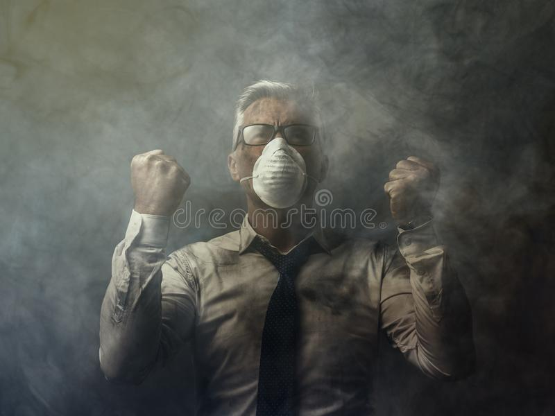 Angry businessman and pollution. Angry businessman with raised fists and polluted air: pollution and business concept royalty free stock images
