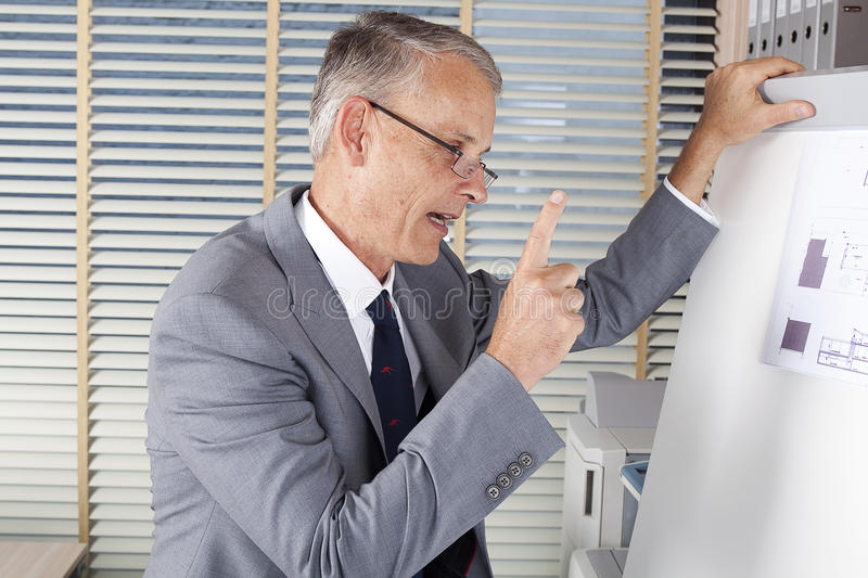 Angry businessman says about the benefits. Angry business man says about the benefits stock photo